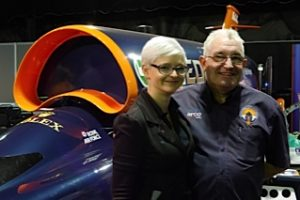 Photo of Jess Herbert and Nick Naylor with a model of the Bloodhound car at the GUTS event, MAGNA