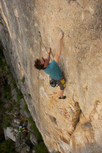 Photo of Jamie climbing